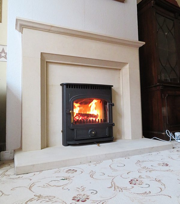 Clearview Vision Inset stove with bespoke stone surround in Nuneaton